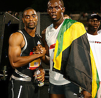 Tyson Gay congratulates Usain Bolt after breaking the World Record in the 100m with a time of 9.72sec. at the Icahn Stadium on Saturday, May 31, 2008. Photo by Errol Anderson, The Sporting Image.