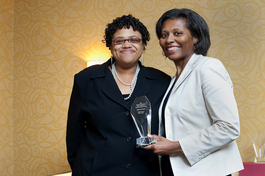 April Hawkins, MetLife Foundation, right, presents an award for Ida Odom to Alisha Knight, left, at the Older Volunteers Enrich America Awards at the Double Tree Hotel in Washington, DC on Friday, June 17, 2011.