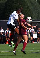 WINSTON-SALEM, NORTH CAROLINA - August 30, 2013:<br />  Rachel Melhado (24) of Louisville University heads down over Katie Yensen (3) of Virginia Tech during a match at the Wake Forest Invitational tournament at Wake Forest University on August 30. The game ended in a 1-1 tie.