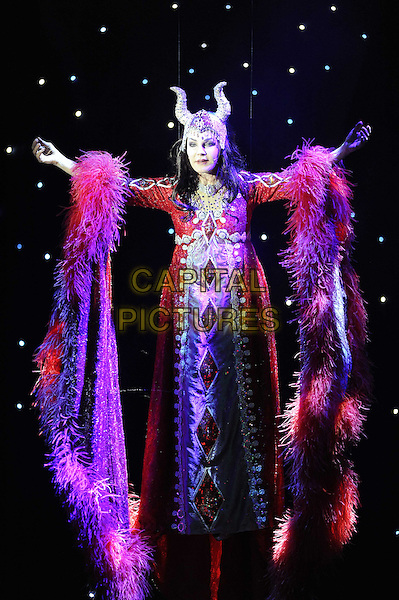 "Priscilla Presley (The Wicked Queen) Takes part in a dress rehearsal for the pantomime ""Snow White And The Seven Dwarfs"", the New Wimbledon Theatre, Wimbledon, London, England..December 6th, 2012.panto on stage performing performing acting costume full length red feather dress  hat horns hands arms .CAP/FIN.©Steve Finn/Capital Pictures."