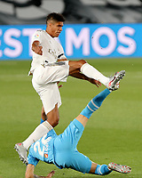 18th June 2020, Alfredo Di Stefano Stadium, Madrid, Spain; La Liga football, Real Madrid versus Valencia;  Real Madrids Raphael Varane controls the ball from Valencias Maxi Gomez