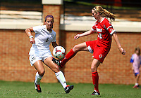 WINSTON-SALEM, NORTH CAROLINA - September 01, 2013:<br /> Kim Sharo(13) of Louisville University kicks the ball away from Jackie McSally (6) of Wake Forest University during a match at the Wake Forest Invitational tournament at Wake Forest University on September 01. The match was abandoned early in the second half due to severe weather with Wake leading 1-0.