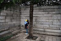 A woman reads a list of names of the victims of the Nanjing Massacre at the Memorial Hall of the Nanjing Massacre in Nanjing, Jiangsu, China on Dec. 13, 2009.  On Dec. 13, 2009, thousands of people visited The Memorial Hall of the Nanjing Massacre in Nanjing, Jiangsu, China, to remember those who died at the hands of Japanese soldiers in 1937-8.  The day marked the 72nd anniversary of the start of the massacre. The historical account has always been mired in controversy, and differing opinions on what actually happened have been a consistent obstacle to relations between China and Japan.  China's official account of history states that 300,000 people were killed by Japanese forces over a 6-week period starting Dec. 13, 1937