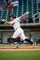 Birmingham Barons designated hitter Seby Zavala (19) follows through on a swing during a game against the Pensacola Blue Wahoos on May 8, 2018 at Regions FIeld in Birmingham, Alabama.  Birmingham defeated Pensacola 5-2.  (Mike Janes/Four Seam Images)