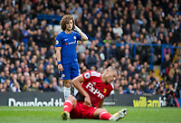 David Luiz of Chelsea looks over injured fellow Brazilian Richarlison of Watford during the Premier League match between Chelsea and Watford at Stamford Bridge, London, England on 21 October 2017. Photo by Andy Rowland.