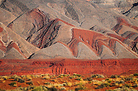 """""""PAINTED HILLS""""<br /> <br /> Painted hills in the Painted Desert. Red rocks and sand paint the desert landscape in the foothills of Monument Valley."""