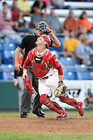 Williamsport Crosscutters catcher Sean McHugh (21) looks for a pop up foul ball in front of umpire Christopher Stump during a game against the Aberdeen IronBirds on August 4, 2014 at Bowman Field in Williamsport, Pennsylvania.  Aberdeen defeated Williamsport 6-3.  (Mike Janes/Four Seam Images)