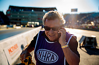 Jun 1, 2018; Joliet, IL, USA; NHRA photographer Richard Shute during qualifying for the Route 66 Nationals at Route 66 Raceway. Mandatory Credit: Mark J. Rebilas-USA TODAY Sports