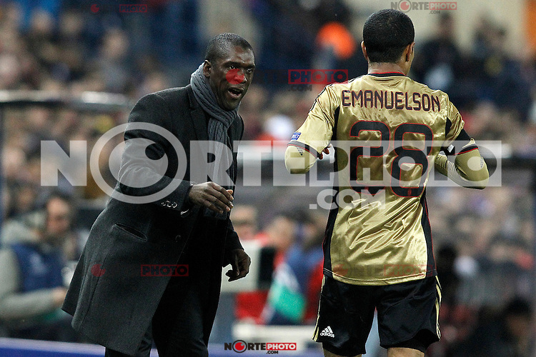 AC Milan's coach Clarence Seedorf (l) with Urby Emanuelson during Champions League 2013/2014 match.March 11,2014. (ALTERPHOTOS/Acero)