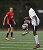 Mo Romeus #10 of The Stony Brook School settles a pass near midfield during the PSAA varsity boys soccer final against Long Island Lutheran at Cantiague Park in Hicksville on Friday, Oct. 26, 2018. He scored on a penalty kick to break a 1-1 tie midway through the second half. Stony Brook went on to win 2-1 to claim the league championship.