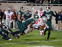 Ohio State Buckeyes running back Ezekiel Elliott (15) scores a rushing touchdown against Michigan State Spartans cornerback Darian Hicks (2) during the 4th quarter at Spartan Stadium in East Lansing, Michigan on November 8, 2014.  (Dispatch photo by Kyle Robertson)