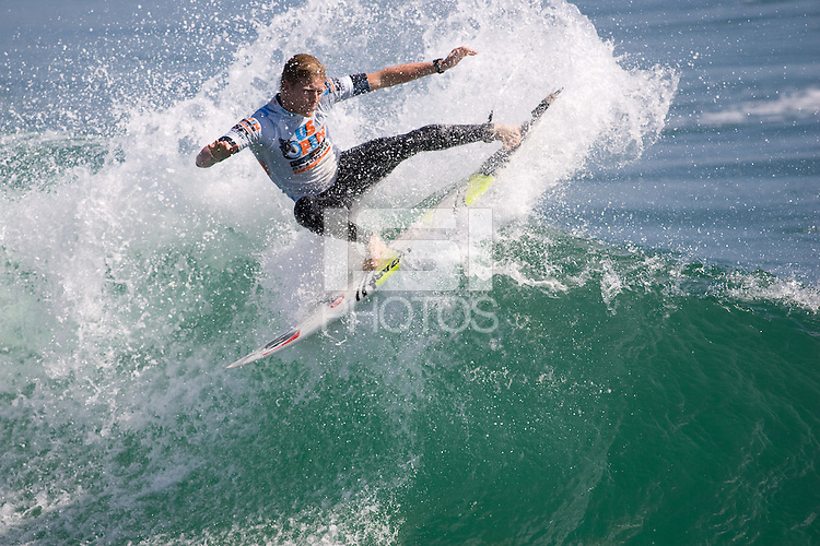 Aussie Lincoln Taylor pulls a front side tail slide during round of 48 at the 2010 US Open of Surfing in Huntington Beach, California on August 5, 2010.