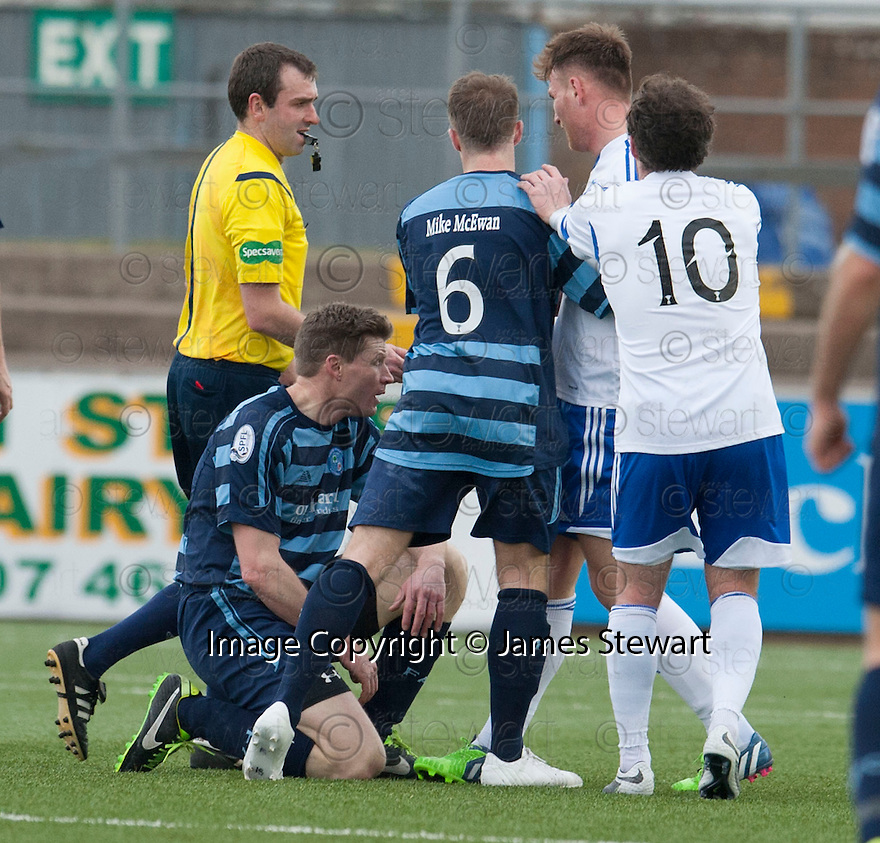 Peterhead's Rory McAllister (2nd right) gets his first yellow card after clashing with Forfar's Darren Dods.