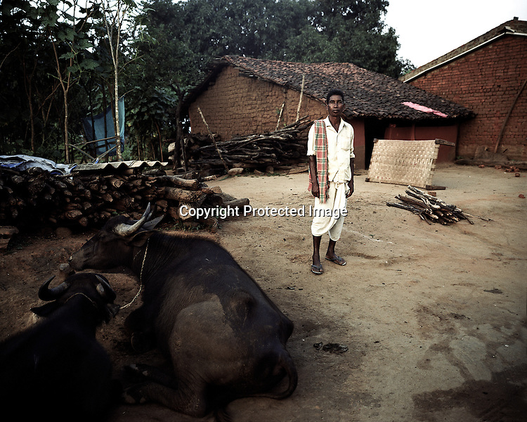 A villager is seen outside his house in Ijurupa village. This village is few metres from the boundary wall of the refinery and causes obstruction of expansion as it falls inbetween the land that has already bought by Vedanta. The villagers are resisting and have decided not to sell the land to the company at any cost.