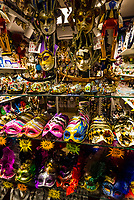 Carnival masks in a shop window during Venice Carnival, Venice, Italy.