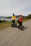 Couple on Segways at Angel Island State Park, San Francisco Bay, California.  Model released.  Photo camari214-70531.  .Photo copyright Lee Foster, www.fostertravel.com, 510-549-2202, lee@fostertravel.com.