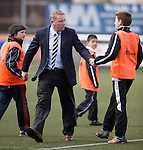 Ally McCoist goes round all the young ballboys and shakes their hand after the match