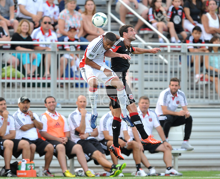 Chris Pontius (13) of D.C. United goes against Darrius Barnes (25) of the New England Revolution. D.C. United defeated the The New England Revolution 3-1 in the Quarterfinals of Lamar Hunt U.S. Open Cup, at the Maryland SoccerPlex, Tuesday June 26 , 2013.
