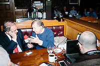"BBC 5 reporter Rhod Sharp interviews former Virginia governor and Republican presidential candidate Jim Gilmore before he gets lunch at the Puritan Backroom in Manchester, New Hampshire, on the day of primary voting, Feb. 9, 2016. Sharp's radio program is called ""Up All Night."" The Puritan Backroom is a long-time favorite stop of political candidates in the state and place where journalists and political junkies hang out on election days hoping to meet candidates. Gilmore finished in last place among major Republican candidates still in the race with a total of 150 votes."