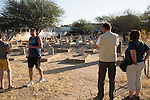 OKAHANDJA, NAMIBIA- AUGUST 11: German tourists visit a German & Herero grave monuments seen at a cemetery in Okahandja, Namibia. The area was the venue for decisive battles of the Herero uprisings in 1904. The Herero accuse the German Empire of Genocide of its people from 1904-07. They are currently trying to make the German government compensate the descendants of the people killed.(Photo by Per-Anders Pettersson)