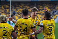 Jordie Barret (centre) celebrates Kobus Van Wyk's try during the Super Rugby Aotearoa match between the Hurricanes and Highlanders at Sky Stadium in Wellington, New Zealand on Sunday, 12 July 2020. Photo: Dave Lintott / lintottphoto.co.nz