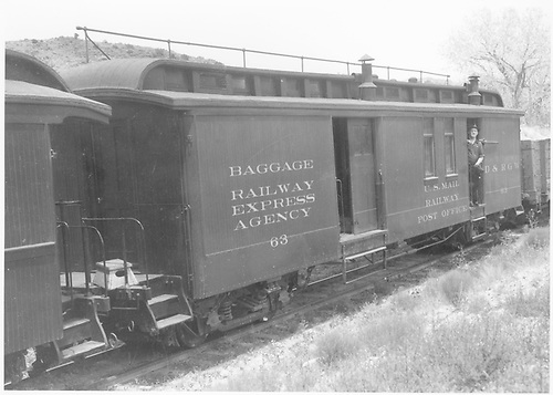 #63 combined baggage &amp; RPO car.  Man standing in door of car. Handrail on roof.  On Santa Fe Branch line.<br /> D&amp;RGW  Santa Fe Branch, NM  Taken by Richardson, Robert W. - 7/3/1941