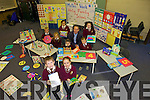 EIGHT PLUS TWO EQUALS TEN:  Nine pupils plus their Principal show the range of activities available for Maths Week in Holy Family primary school this week. From front l-r were: Paul Browne and Sophie Hennnessy. Back l-r were: Niall Fitzmaurice, Patricia Oprisan, Labhras Long, Peter Dineen, Faith Efegebare, Ed O'Brien (Principal) and Holly Moriarty.