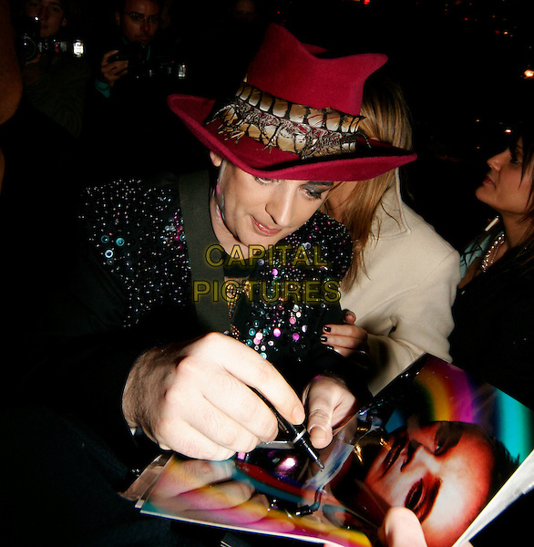 BOY GOERGE.The Brit Awards aftershow party at Nobu, London, UK..February 15th, 2006.Ref: SW.Brits half length make up hat signing autoghraph.www.capitalpictures.com.sales@capitalpictures.com.©Capital Pictures.