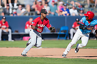 Vancouver Canadians third baseman Otto Lopez (5) chases Starling Joseph (39) in a rundown during a Northwest League game against the Spokane Indians at Avista Stadium on September 2, 2018 in Spokane, Washington. The Spokane Indians defeated the Vancouver Canadians by a score of 3-1. (Zachary Lucy/Four Seam Images)