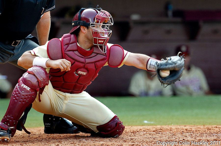 TALLAHASSEE, FL 10-FSU-TAMUBASE11 CH-Florida State's catcher Rafael Lopez snags a pitch against Texas A&M's Sunday at Dick Howser Stadium during NCAA Super Regional action in Tallahassee. The Seminoles beat the Aggies 23-9 to stay alive in the best of three series...COLIN HACKLEY PHOTO