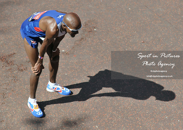 Mo Farah (GBR) bends over at the end of the race. Virgin Money London Marathon. London. UK. 13/04/2014. MANDATORY Credit Garry Bowden/Sportinpictures - NO UNAUTHORISED USE - 07837 394578