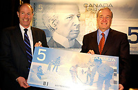 March 27. 2002, Montreal, Quebec, Canada; <br /> <br /> Paul Martin,Canada's Minister of Finance (and possible replacement to Liberal leaderJean Chretien) (R)<br />  and David Dodge, Governor of the Bank of Canada (L) <br /> unveil The second bank note in the new Canadian<br /> Journeyl, March 27th, 2002  in Montreal, Canada.<br /> <br /> Guests including Jean B&raquo;liveau, former NHL hockey player for the Montr&raquo;al Canadiens,<br />  Kim St. Pierre, member of the gold-medal-winning<br /> Canadian Olympic women's hockey team in Salt Lake City,<br />  and Myriam B&raquo;dard, Olympic gold medallist in the biathlon <br /> where attending the event that took place early this morning at the AMC Pepsi Forum Cinemas (build onside the former Forum hockey rink).<br /> <br /> The new $5 note will be available at financial institutions across Canada at approximately 10:30 a.m., on Wednesday, 27 March 2002<br />     <br /> <br /> <br /> NOTE :  D-1 H original JPEG, saved as Adobe 1998 RGB