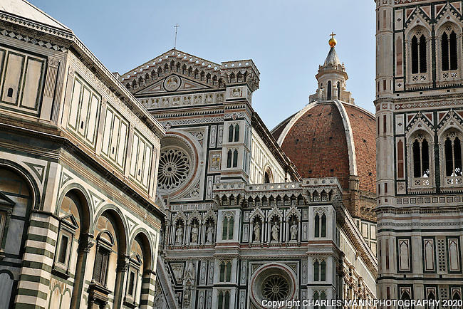 The colorful Duomo cathedral dominates the central plaza or piazza of Florence.