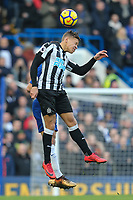 Dwight Gayle of Newcastle United wins the ball in the air during the Premier League match between Chelsea and Newcastle United at Stamford Bridge, London, England on 2 December 2017. Photo by David Horn.