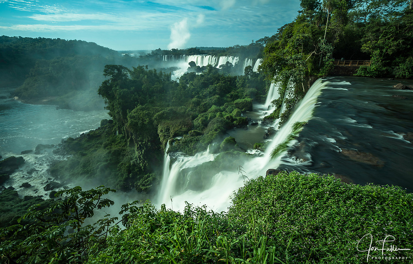 Iguazu Falls National Park in Argentina.  A UNESCO World Heritage Site.  Pictured from left to right are the San Martin, Mbigua, Bernabe Mendez, Adam and Eve, and Bossetti Falls.  At the far left in the distance is the Santa Maria Falls on the Brazil side with the mist plume of the Devil's Throat Falls.