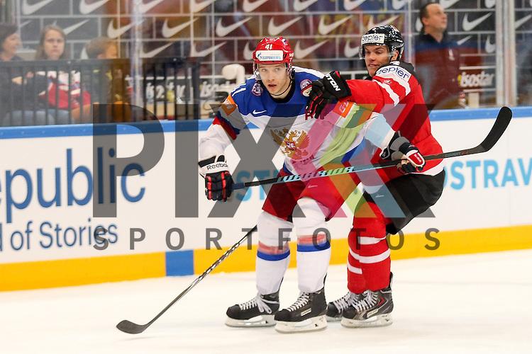 Russlands Kulyomin, Nikolai (Nr.41)(New York Islander) im Zweikampf mit Canadas Hall, Taylor (Nr.4)  im Spiel IIHF WC15 Finale Russia vs. Canada.<br /> <br /> Foto &copy; P-I-X.org *** Foto ist honorarpflichtig! *** Auf Anfrage in hoeherer Qualitaet/Aufloesung. Belegexemplar erbeten. Veroeffentlichung ausschliesslich fuer journalistisch-publizistische Zwecke. For editorial use only.