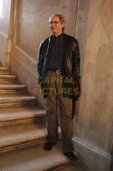 KEN LOACH.3 December 2003.black leather jacket, steps, stairs, full length, full-length.www.capitalpictures.com.sales@capitalpictures.com.© Capital Pictures