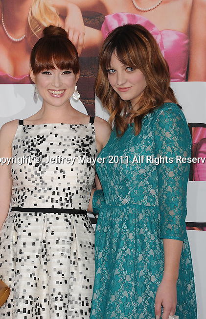 "WESTWOOD, CA - APRIL 28: Abby Elliott and Ellie Kemper arrive at the premiere of Universal Pictures' ""Bridesmaids"" held at Mann Village Theatre on April 28, 2011 in Los Angeles, California."