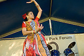 Bangladeshi dancer performs at Queens Park Gardens summer festival, West London.