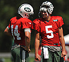 Christian Hackenberg #5, New York Jets rookie quarterback, right, chats with starting quarterback #14 Ryan Fitzpatrick during training camp at Atlantic Health Jets Training Center in Florham Park, NJ on Saturday, Aug. 13, 2016.