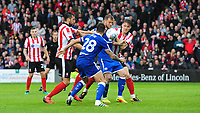 Lincoln City's Ollie Palmer, left, with team-mate Sean Raggett vies for possession with Chesterfield's Robbie Weir, second in from left, and Chesterfield's Scott Wiseman<br /> <br /> Photographer Chris Vaughan/CameraSport<br /> <br /> The EFL Sky Bet League Two - Lincoln City v Chesterfield - Saturday 7th October 2017 - Sincil Bank - Lincoln<br /> <br /> World Copyright &copy; 2017 CameraSport. All rights reserved. 43 Linden Ave. Countesthorpe. Leicester. England. LE8 5PG - Tel: +44 (0) 116 277 4147 - admin@camerasport.com - www.camerasport.com