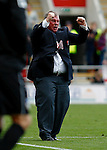 Rotherham United v Oldham Athletic<br /> 14.9.2013<br /> Sky Bet League 1.<br /> Picture Shaun Flannery/Trevor Smith Photography<br /> Rotherham Manager Steve Evans celebrates his team's winning goal to the Oldham fans.