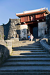 """Visitors walk down the steps from Zuisenmon gate inside the grounds of Shuri-jo Castle  in Naha, Okinawa Prefecture, Japan, on June 24, 2012. Zuisenmon, which means """"splendid and auspicious spring,"""" takes its name from the Ryuhi"""" spring just in front of it. Photographer: Robert Gilhooly"""