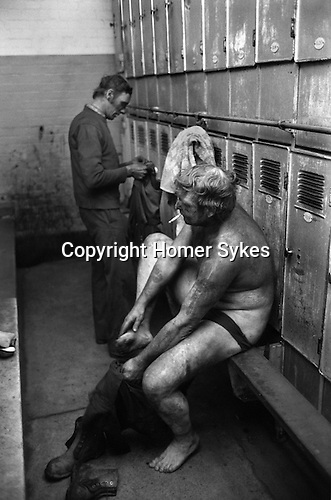Snowdown Colliery, Snowdown Kent. Miners in locker room having just come off a shift.<br /> <br /> Albert Christian standing. <br /> <br /> Caption names thanks to Darran Cowd<br /> Museum &amp; Heritage Manager, Betteshanger Sustainable Parks,
