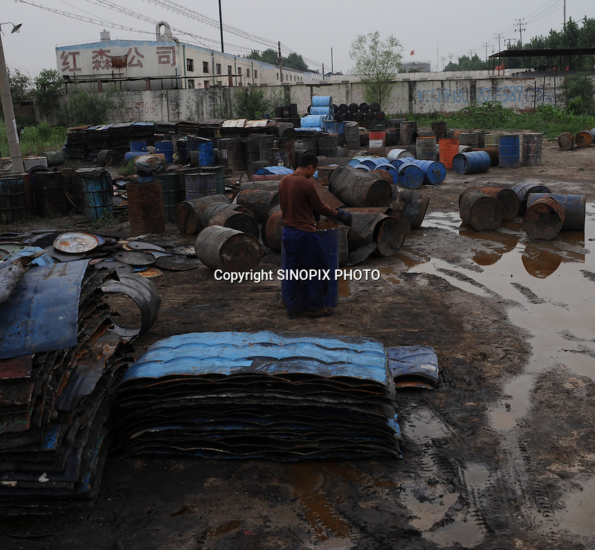 "A plant recycles barrels from the hundreds of chemical factories at Xiditou. Xiditou is known as one of China's worse ""cancer villages"" where a reported ten percent have died from cancer."