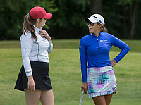 Maria Fassi (right) talks to her caddy Olivia Lavy, both former Arkansas golfers, Tuesday, June 23, 2020, during the pro-am round of the Cooper Northwest Arkansas Charity Classic golf tournament at Bella Vista Country Club. Go to nwaonline.com/200624Daily/ to see more photos.<br /> (NWA Democrat-Gazette/Ben Goff)