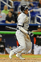 7 March 2012:  FIU shortstop Julius Gaines (2) bats as the Miami Marlins defeated the FIU Golden Panthers, 5-1, at Marlins Park in Miami, Florida.