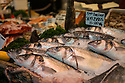 London, UK. 15.11.2014. Seabass on a fishmonger's stall at Borough Market. Photograph © Jane Hobson.