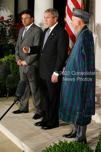 WASHINGTON - SEPTEMBER 27:  (AFP OUT) (L-R) Pakistani President Pervez Musharraf, U.S. President George W. Bush and Afghanistan President Hamid Karzai stand in the Rose Garden while Bush delivers remarks at the White House September 27, 2006 in Washington, DC. Bush is hosting a meeting between the two leaders. (Photo by Chip Somodevilla/Getty Images) *** Local Caption *** Hamid Karzai;George W. Bush;Pervez Musharraf