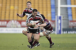John Fonokalafi tries to break the tackle of Kane Thompson during the Air NZ Cup game between the Counties Manukau Steelers and Southland played at Mt Smart Stadium on 3rd September 2006. Counties Manukau won 29 - 8.